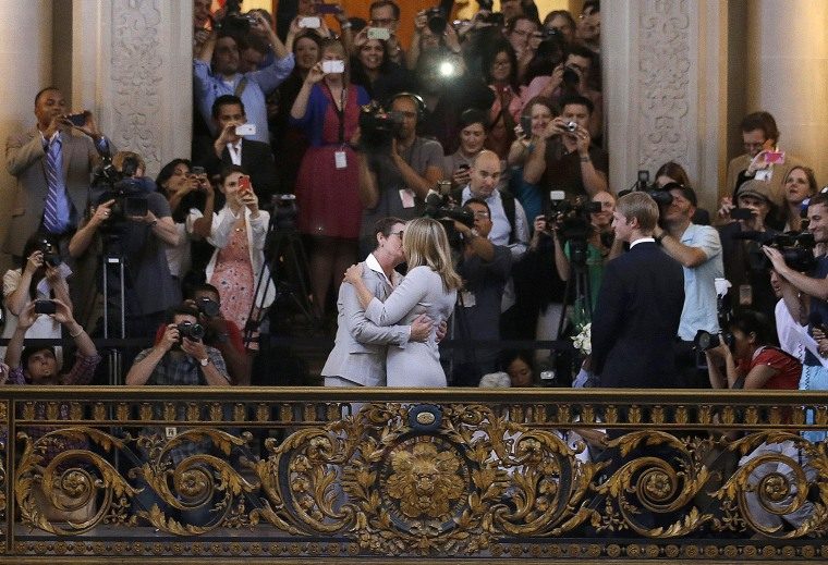 Kris Perry kisses Sandy Stier as they are married at City Hall in San Francisco, Friday, June 28, 2013. (Photo by Jeff Chiu/AP)