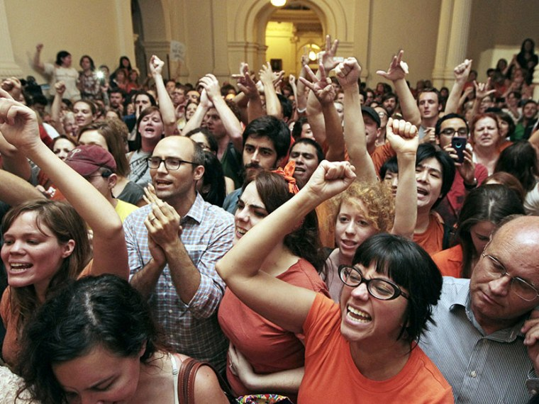Reproductive rights advocates fill the Texas capitol celebrating the defeat of the controversial anti-abortion bill SB5, which was up for a vote on the last day of the legislative special session June 25, 2013 in Austin, Texas.(Photo by Erich Schlegel...