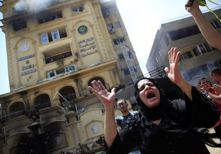 An Egyptian woman chants slogans, as protesters ransack the Muslim Brotherhood headquarters in the Muqattam district in Cairo, Monday, July 1, 2013. Protesters stormed and ransacked the headquarters of President Mohammed Morsi's Muslim Brotherhood...