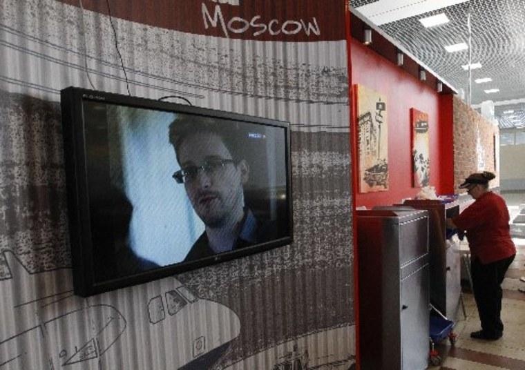 A television screens the image of former U.S. spy agency contractor Edward Snowden during a news bulletin at a cafe at Moscow's Sheremetyevo airport June 26, 2013. Russian President Vladimir Putin confirmed on Tuesday that Snowden, sought by the United...