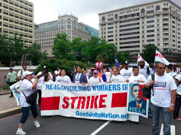 Federally contracted workers march in a protest against alleged wage theft and worker intimidation by Ronald Reagan Building employers on July 2, 2013 in Washington, D.C. (Photo courtesy GoodJobsNation.org)