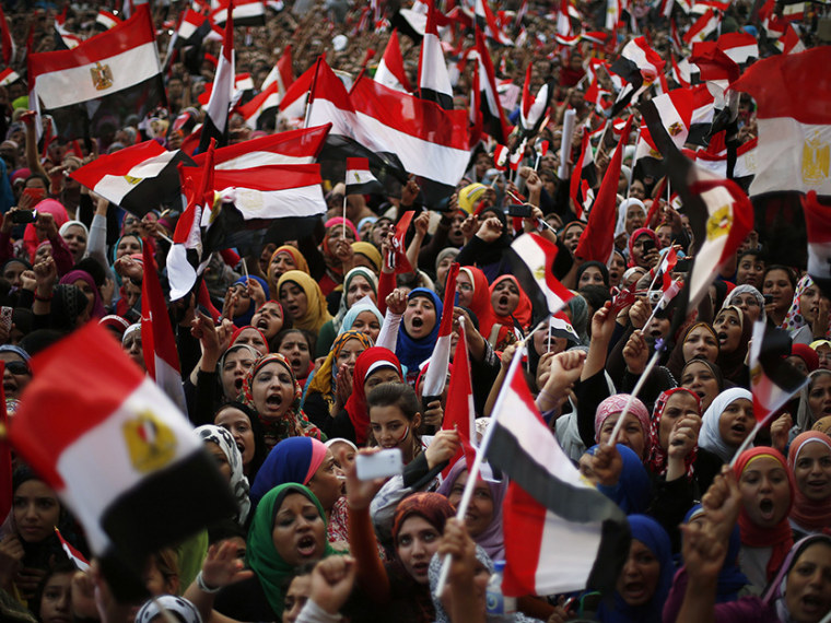 Protesters take part in a protest demanding that Egyptian President Mohamed Mursi resign at Tahrir Square in Cairo July 1, 2013. Egypt's powerful armed forces gave Islamist President Mohamed Mursi a virtual ultimatum on Monday to share power, urging...