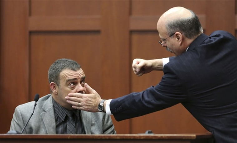 Prosecutor Bernie de la Rionda, right, demonstrates a possible scenario while questioning state's witness Chris Serino, a Sanford police officer, during the George Zimmerman trial on Tuesday, July 2 in Sanford, Fla. (Joe Burbank / AP)