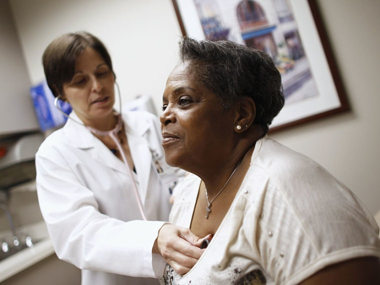 Patient Joan West (R) receives a check up from Dr. Lisa Vinci at University of Chicago Medicine Primary Care Clinic in Chicago June 28, 2012. (Photo by Jim Young/Reuters)