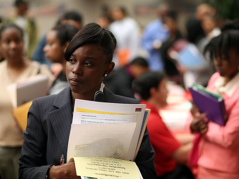 Job seekers wait in line to meet with a recruiter during a job and career fair at City College of San Francisco southeast campus on May 30, 2013 in San Francisco, California.  (Photo by Justin Sullivan/Getty Images)