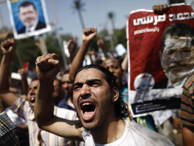 An Egyptian supporter of the Muslim Brotherhood and ousted president Mohamed Morsi shouts religious and political slogans during a protest near Cairo University in the Egyptian capital on July 5, 2013.  (Photo by Mahmoud Khaled/AFP/Getty Images)
