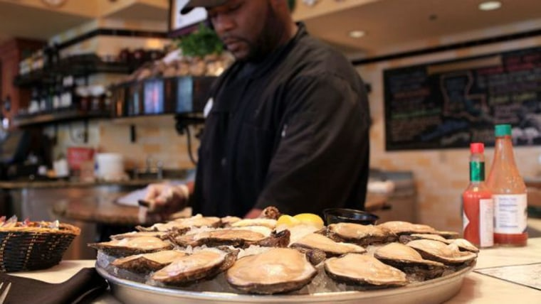 Rickey Lee shucks Louisiana oysters from area 7 at the Bourbon House restaurant on June 9, 2010 in New Orleans, Louisiana. Restaurants like the Bourbon House in the heart of the French Quarter are still serving fresh oysters daily. Due to the ongoing...
