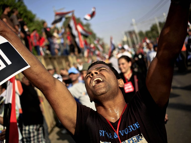 An opponent of Egypt's Islamist President Mohammed Morsi chants slogans during a protest outside the presidential palace, in Cairo, Egypt, Wednesday, July 3, 2013. The deadline on the military's ultimatum to President Mohammed Morsi has expired, with...