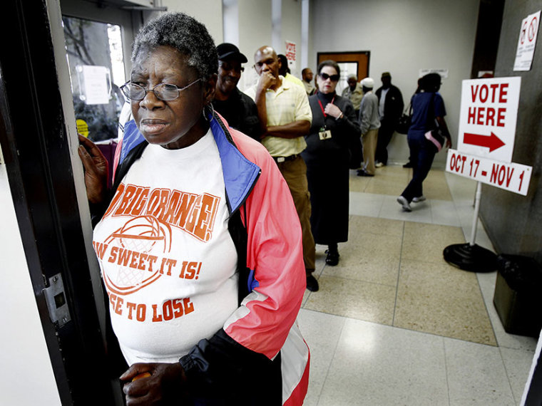 Virginia Louise Boner, 69, (front) waits in line with fellow Shelby County residents during the first day of early voting, October 17, 2012 in Memphis, TN (Photo by Mark Weber/The Commercial Appeal/ZUMAPRESS.com)