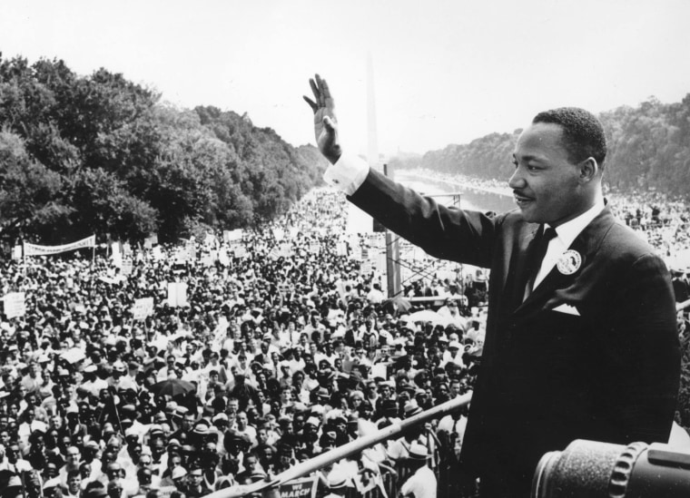 "Martin Luther King Jr. waves to the crowd at the March on Washington in August of 1963, where he gave his famous ""I have a dream..."" speech."