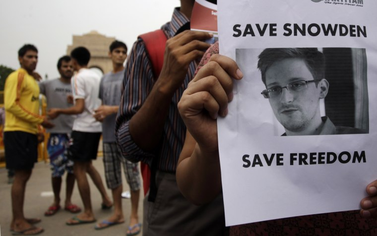 Indian protestors show their support for NSA leaker Edward Snowden at India Gate in New Delhi, India, Sunday, July 7, 2013.  (AP Photo/Tsering Topgyal)