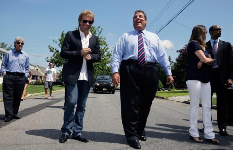 Singer Jon Bon Jovi walks in his hometown of Sayreville, N.J., with New Jersey Gov. Chris Christie on July 8, 2013. (Photo by Mel Evans, Pool/AP)