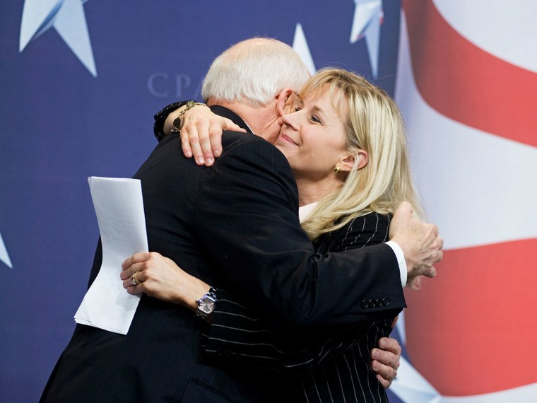 Former Vice President Dick Cheney hugs his daughter, Liz Cheney, after she surprised the Conservative Political Action Conference (CPAC) by bringing him as her guest. (AP Photo/Cliff Owen)