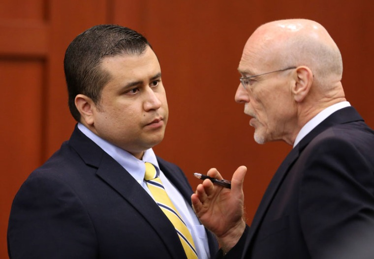 George Zimmerman, left,  speaks to defense counsel Don West during a recess in his trial in Seminole circuit court, in Sanford, Fla., Monday, July  8, 2013. Zimmerman is charged with second-degree murder in the fatal shooting of Trayvon Martin, an...