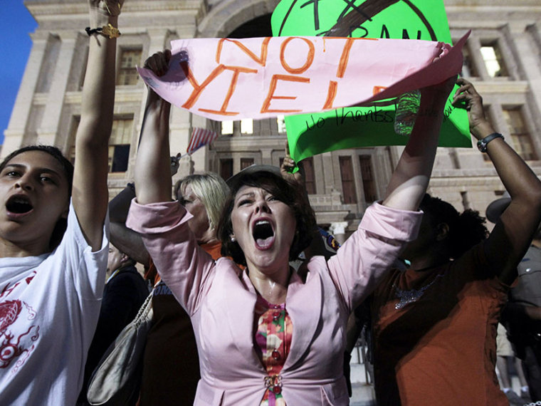 Pro-choice protester Julia Ann Nitsch of Austin, center, chants as pro-life supporters and pro-choice protesters rally at the Texas state capitol in favor and against the new controversial abortion legislation up for a vote in the state legislature on...