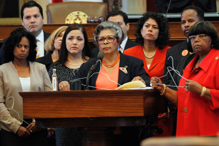 Rep. Senfronia Thompson listens to questions with other representatives regarding her proposed amendment to allow abortion as late as twenty-four weeks in cases of incest and rape as the House of Representatives meet to vote on legislation restricting...