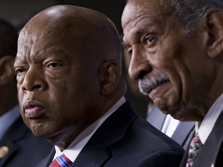 Rep. John Lewis, D-Ga., left, and Rep. John Conyers, D-Mich., right, co-chairs of the Civil Rights Taskforce of the Congressional Black Caucus, join members of the House to comment on the Supreme Court's decision on Shelby County v. Holder that...