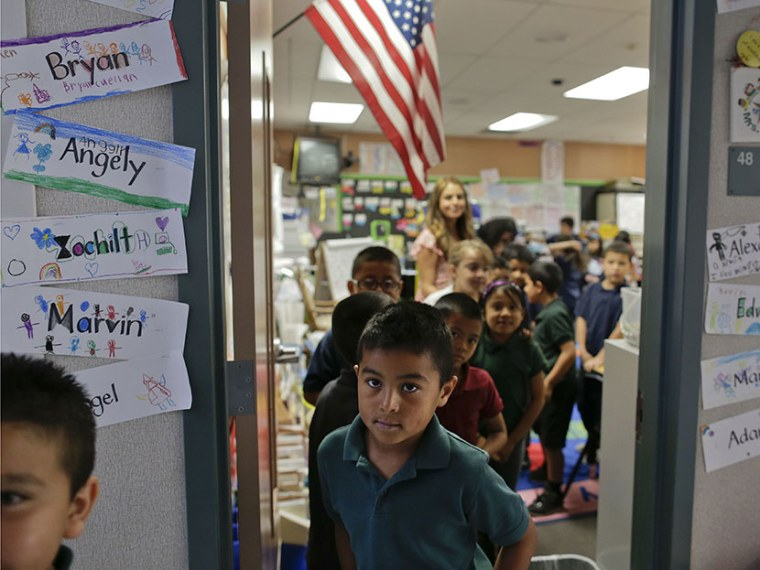 In this Thursday, May 23, 2013 photo, students in Lisa Cabrera-Terry's first grade class line up to go to recess at Jay W. Jeffers Elementary School, in Las Vegas. (Photo by Julie Jacobson/AP)
