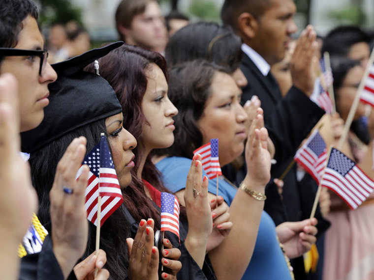"""DREAMers (Development, Relief, and Education for Alien Minors) and parents take an oath in a mock citizenship ceremony during a """"United We Dream,"""" rally on Capitol Hill in Washington, Wednesday, July 10, 2013, sending a signal to the House of..."""