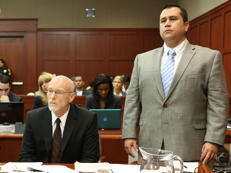 George Zimmerman stands for instructions from Judge Debra Nelson with attorney Don West, during his trial in Seminole circuit court in Sanford, Fla. Thursday, July 11, 2013. (Photo by Gary W. Green/Orlando Sentinel/Pool/AP)