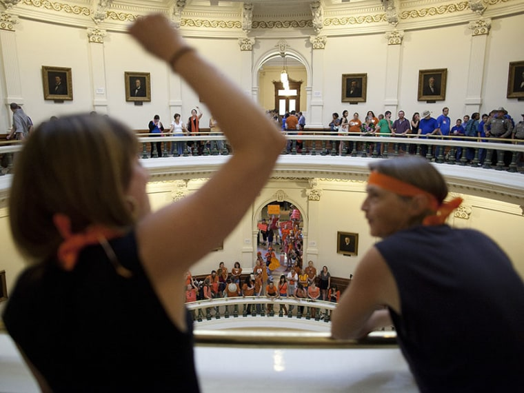 Hallie Boas and Lisa Fithian lead abortion rights chants from the third floor of the Texas Capitol Rotunda in Austin, Texas on Friday, July 12, 2013.  (Photo by Tamir Kalifa/AP)