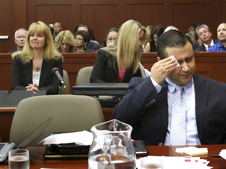 George Zimmerman wipes his face after arriving in the courtroom in Sanford, Florida July 12, 2013. (Photo by Joe Burbank/Pool/Reuters)