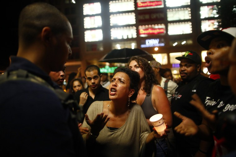People react after hearing the news that George Zimmerman was found not guilty in the 2012 shooting death of Trayvon Martin, in New York July 13, 2013.  (Photo by Eric Thayer/Reuters)