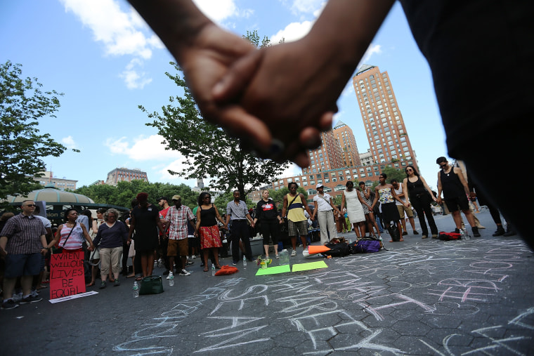 NEW YORK, NY - JULY 14:  People hold hands in a circle at a rally honoring Trayvon Martin at Union Square in Manhattan on July 14, 2013 in New York City. George Zimmerman was acquitted of all charges in the shooting death of Martin July 13 and many...