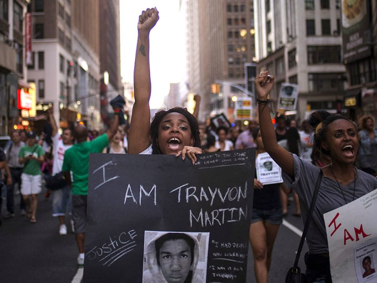 A woman yells slogans with demonstrators supporting Trayvon Martin while marching to Times Square from New York's Union Square on July 14, 2013.  (Photo by Adrees Latif/Reuters)