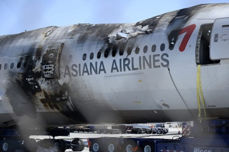 The wreckage of the Asiana Airlines Flight 214 is moved off site to a secure area away from the runway at San Francisco International Airport in San Francisco, California, July 12, 2013. (Photo by John G. Mabanglo/EPA)