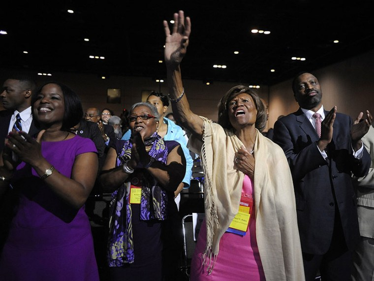 Hazel Dukes, a member of the board of directors of the National Association for the Advancement of Colored People (NAACP), cheers at the end of a speech by NAACP president Benjamin Jealous to the 2013 NAACP convention in Orlando, Florida July 15, 2013....