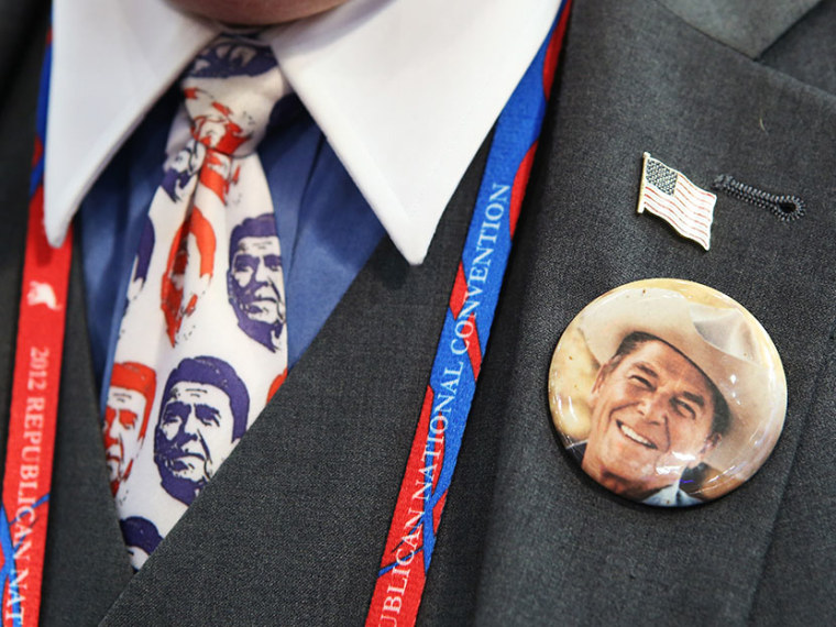 A convention-goer wears a former President Ronald Reagan button and tie during the final day of the Republican National Convention at the Tampa Bay Times Forum on August 30, 2012 in Tampa, Florida. (Photo by Chip Somodevilla/Getty Images)