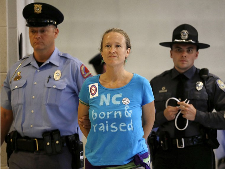 """A woman is arrested outside the House and Senate chambers during \""""Moral Monday\"""" protests at the General Assembly in Raleigh, N.C., Monday, June 24, 2013. (Photo by Gerry Broome/AP)"""