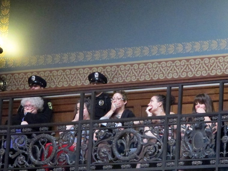 Opponents of a series of Republican-backed bills dealing with abortions hold their hands over their mouths while watching debate in the state Assembly on Thursday, June 13, 2013, in Madison, Wis.  (Photo by Scott Bauer/AP)