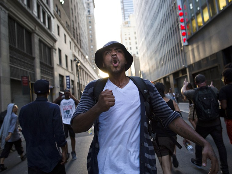 A demonstrator chants, Sunday, July 14, 2013, in New York, during a march against the acquittal of neighborhood watch member George Zimmerman in the killing of 17-year-old Trayvon Martin in Florida.  (Photo by John Minchillo/AP)