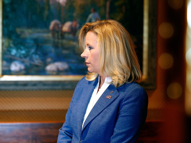 Wyoming Senate candidate Liz Cheney waits in the hallway for a news conference to begin at the Little America Hotel and Resort in Cheyenne, Wyoming on July 17, 2013. (Marc Piscotty/Getty Images)