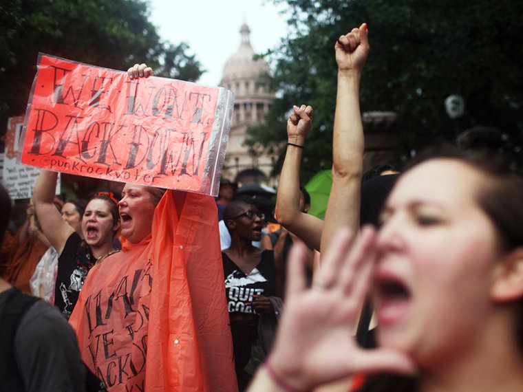 Hundreds of abortion rights demonstrators rally outside of the State Captiol to protest recent legislation that could shut down all but five clinics and restrict abortion rights throughout the state in Austin, Texas on Monday, July 15, 2013. (Photo by...