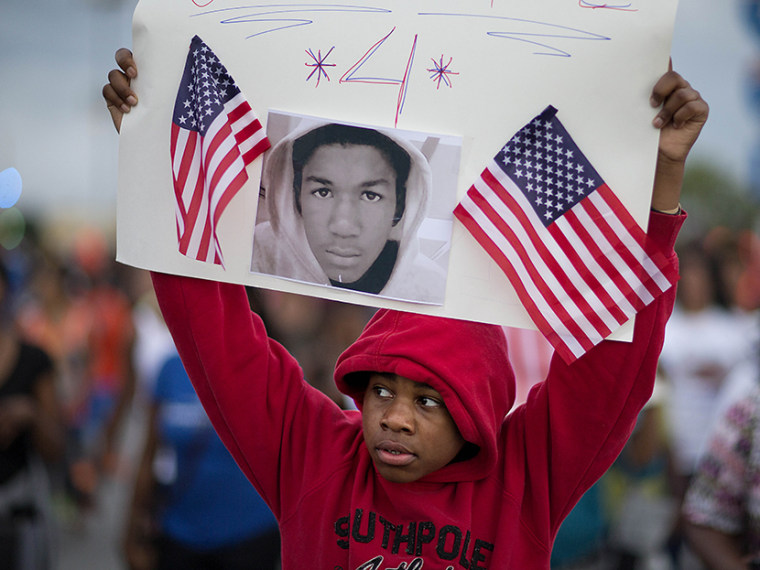 Jaylen Reese, 12, of Atlanta, marches to downtown during a protest of George Zimmerman's not guilty verdict in the 2012 shooting death of teenager Trayvon Martin, Monday, July 15, 2013, in Atlanta. (Photo by David Goldman/AP)