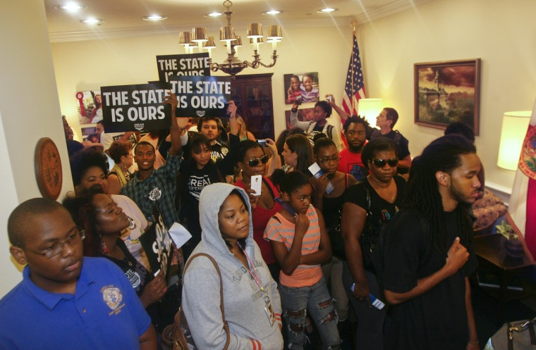 Protesters crowd into Florida Gov. Rick Scott's office Tuesday July 16, 2013, at the Capitol in Tallahassee, Fla. Dream Defenders organized a sit-in of Florida Gov. Rick Scott's office in response to the 'not guilty' verdict in the trial of George...