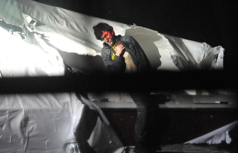 Boston bombing suspect Dzhohkar Tsarnaev emerging from a boat on April 19, 2013 in Watertown, Massachusetts. (Photo by Sgt. Sean Murphy/Boston Magazine)