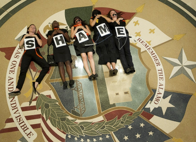 July 18, 2013 - Austin, Texas, U.S. - Abortion rights supporters demonstrate outside the Capitol auditorium where Gov. R. Perry signed the abortion restriction bill that will outlaw abortions after 20 weeks and force abortion clinics and doctors to...
