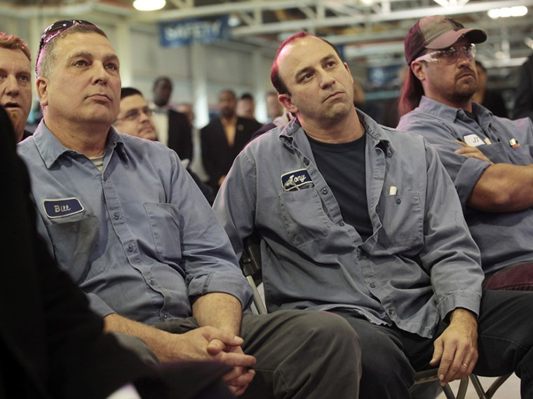 Chrysler Mack I Engine Plant assembly workers Bill Galecki (L), Tony Russo and John Terry (R) listen during a news conference to announce a major financial investment and more jobs added to the engine plant in Detroit, Michigan November 15, 2012. ...