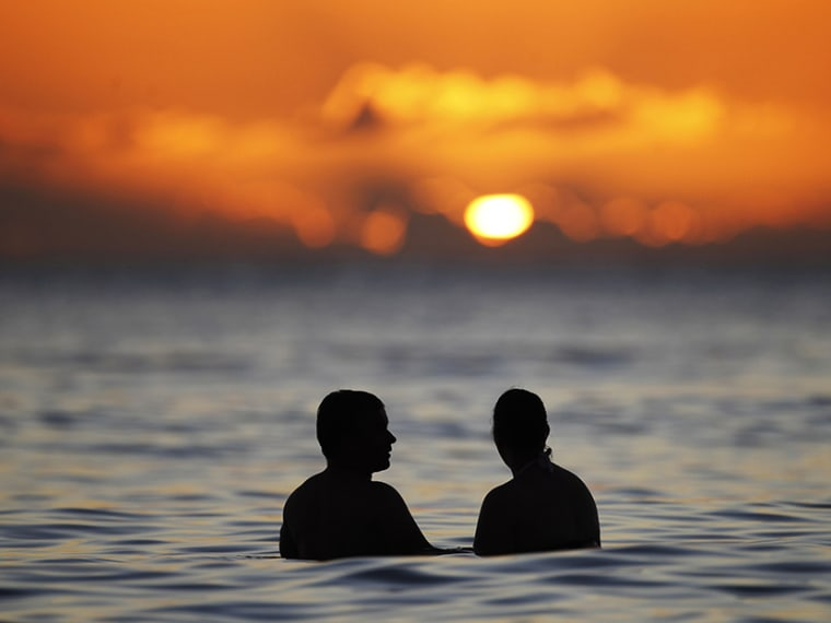 Sunset from the waters off Waikiki Beach in Honolulu, Hawaii. (File photo by Jason Reed/Reuters)