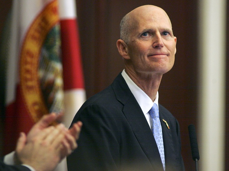 Gov. Rick Scott smiles as he receives applause during his State of the State address Tuesday, March 5, 2013, in the Florida House of Representatives in Tallahassee, Fla. (Photo by Phil Sears/AP)