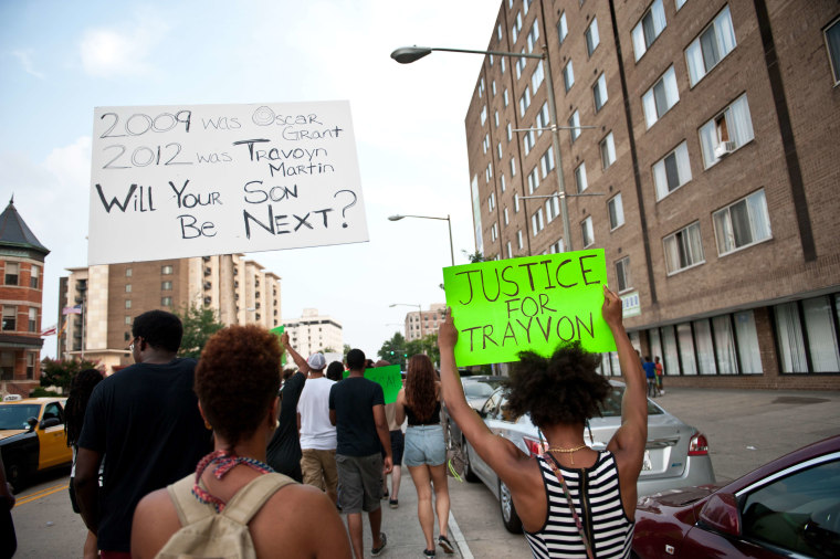 People march in Washington on July 19, 2013 during a demonstration against the acquittal of George Zimmermann in the killing of unarmed Florida teen Trayvon Martin. (Photo by Nicholas Kamm/AFP/Getty)