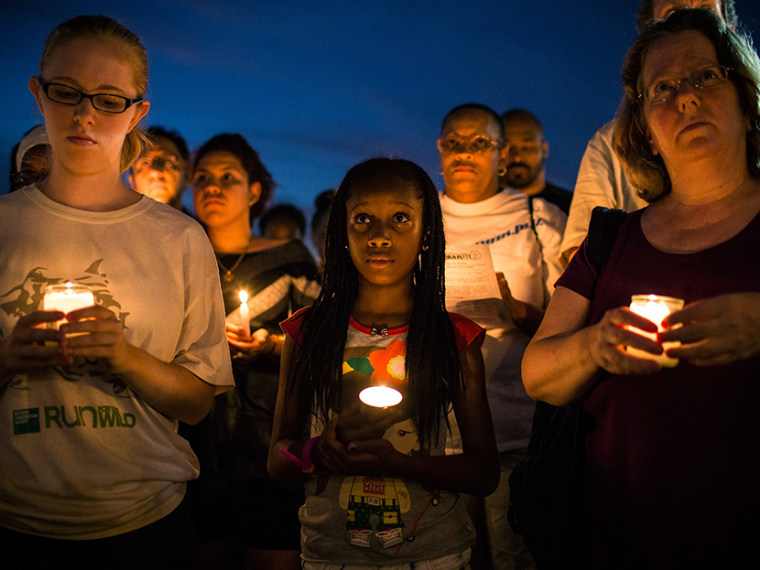 Aaliyah Wright, 9, participates in a candle lit vigil for Trayvon Martin, the teenager who was shot and killed in Florida last year, on July 15, 2013 in New York City. (Photo by Andrew Burton/Getty Images)