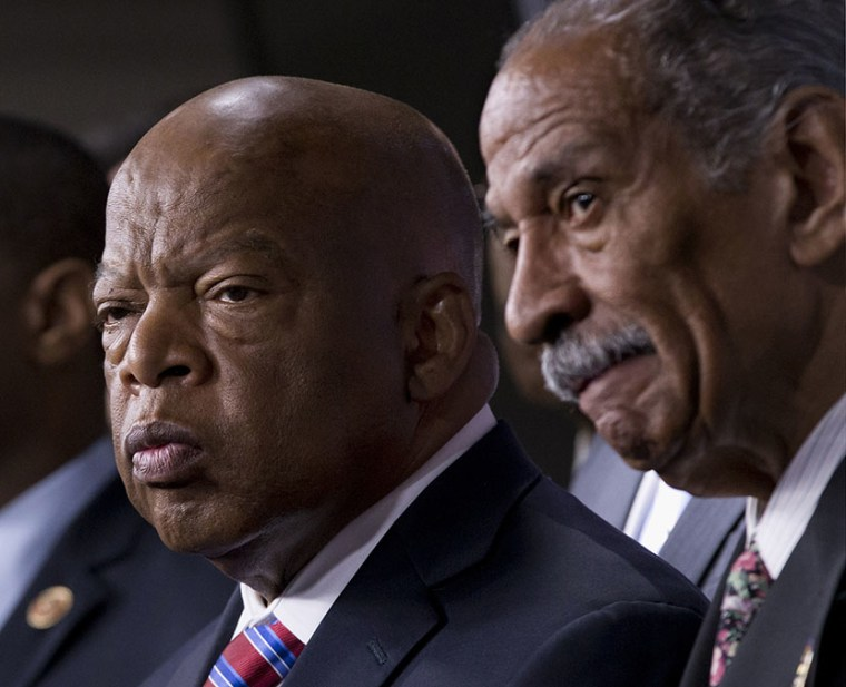 Rep. John Lewis, D-Ga., left, and Rep. John Conyers, D-Mich., right, co-chairs of the Civil Rights Taskforce of the Congressional Black Caucus, join other members of the House to express disappointment in the Supreme Court's decision on Shelby County v...