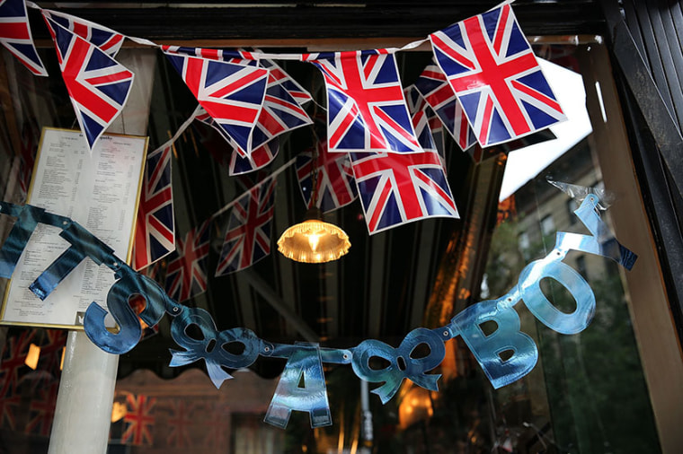 """A sign in the window of the British restaurant and grocery Tea & Sympathy reads. """"It's A Boy"""" as it celebrates the birth of Catherine, Duchess of Cambridge, and her husband Prince William's first child on July 22, 2013 in New York City. (Photo by..."""