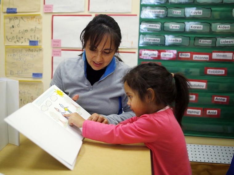 Paola Garcia reads a book with her three-year-old daughter Emily at Action for Boston Community Development's (ABCD) Head Start program in the Roslindale neighborhood of Boston, Massachusetts March 5, 2013. According to ABCD, 95 percent of the money...