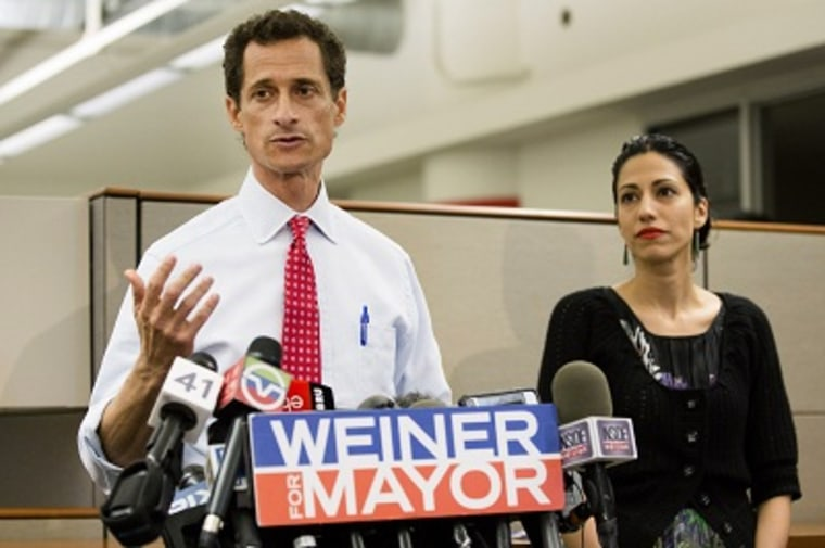 New York mayoral candidate Anthony Weiner speaks during a news conference alongside his wife Huma Abedin at the Gay Men's Health Crisis headquarters, Tuesday, July 23, 2013, in New York. The former congressman says he's not dropping out of the New York...